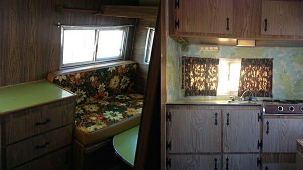 interno della roulotte arruginita cucina e divanetti